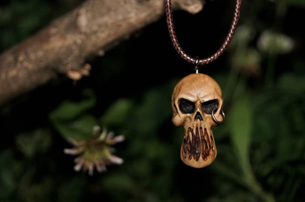Hand carved wood pendant